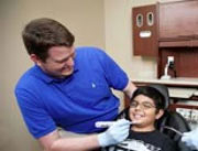 Dr. Jon McClure works with a pediatric dental patient